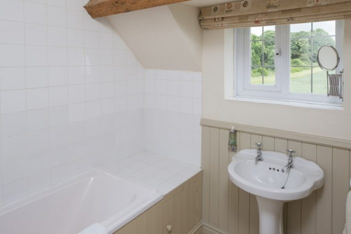 The family bathroom on the first floor has fabulous views across the surrounding fields.