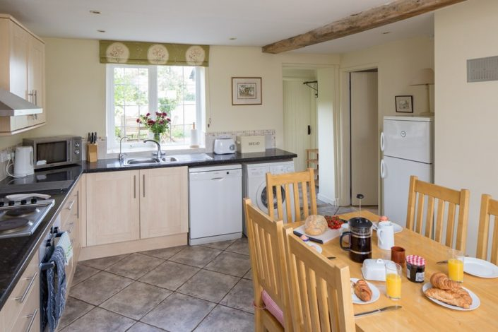 The kitchen is very well-equipped with plenty of space for the dining-area.