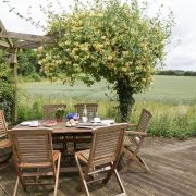 The rear decked terrace has uniterrupted views across the surrounding fields.