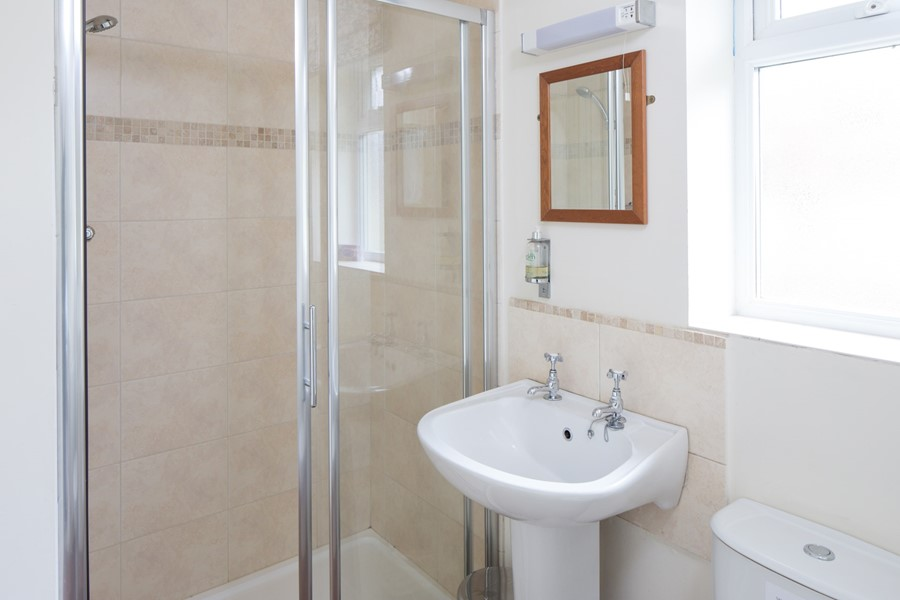 The en suite shower-room for Bedroom 1 has access from the utility-area too.