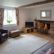 The spacious sitting-room has a cosy open fire.